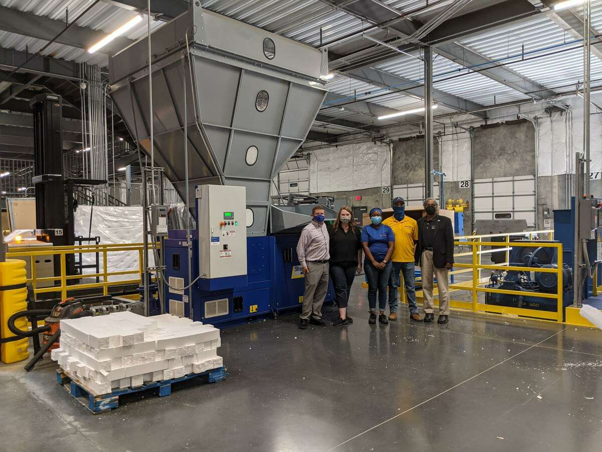 The state-of-the-art recycling facility at the American Furniture Warehouse's store in Webster. Pictured above from left are Brandon Grange, Alyssa Vogel, Kourtney Mcqueen, Logan Treme and Oli Mohammed.