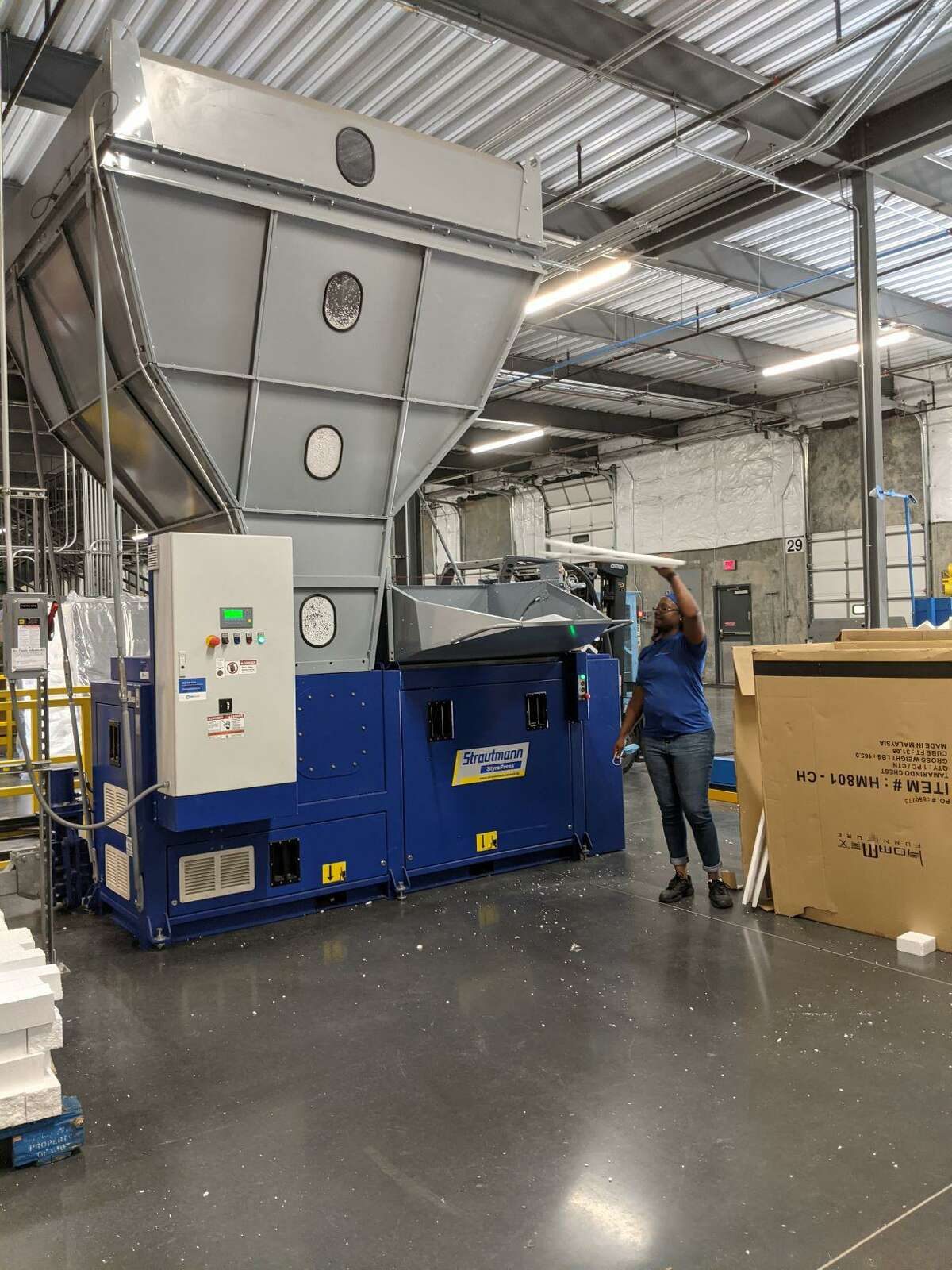"""Styrofoam, which many recycling centers do not accept, is put in a """"Styropress"""" - a briquetting machine which reprocesses it into bricks that can be used for construction work."""