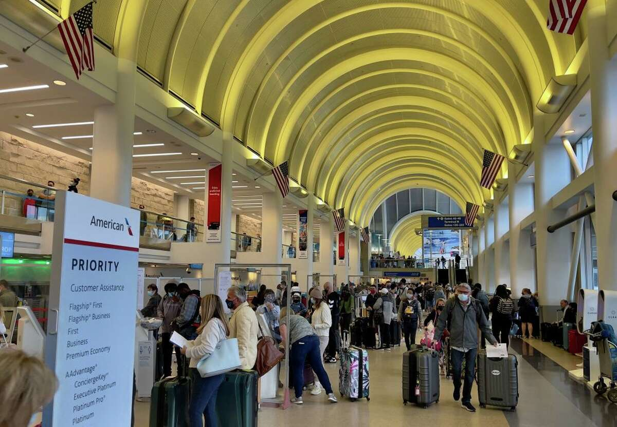 Passengers check in at the American Airlines counters at the Los Angeles International Airport (LAX) on April 24, 2021.