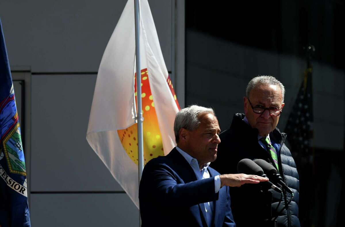 Globalfoundries CEO Tom Caulfield, left, and U.S. Senate Majority Leader Charles Schumer, right, announceme that GlobalFoundries will move its company headquarters to their Fab 8 manufacturing facility in Malta on Monday, April 26, 2021, during a press conference at Globalfoundries in Malta, N.Y. (Will Waldron/Times Union)