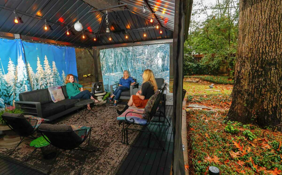 Sharon Brier, center, socially-distance visits with neighbors, Christine and Kylie Baker. Brier set up a gazebo in her backyard so she could continue with a small-scale social life.