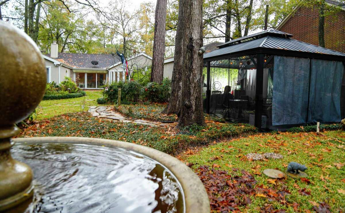 """Exterior of Sharon Brier's outdoor gazebo/patio room, Wednesday, December 30, 2020, in Houston. She and her husband created after the pandemic started, and she keeps a refrigerator there, created a backdrop to """"hide"""" the garage and has added other things so she can sit out there with friends safely during the pandemic."""