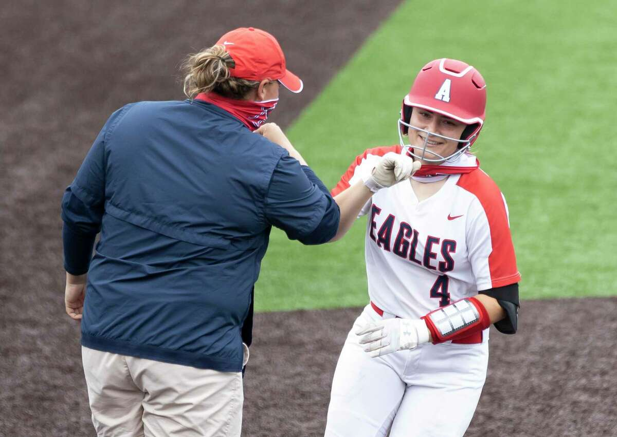 Katie Cimusz #4 of Atascocita bumps elbows with her head coach Ashley Boyd after she hits a homerun during the third inning of a non-district softball game against Deer Park at Humble High School, Tuesday, March 16, 2021, in Humble.