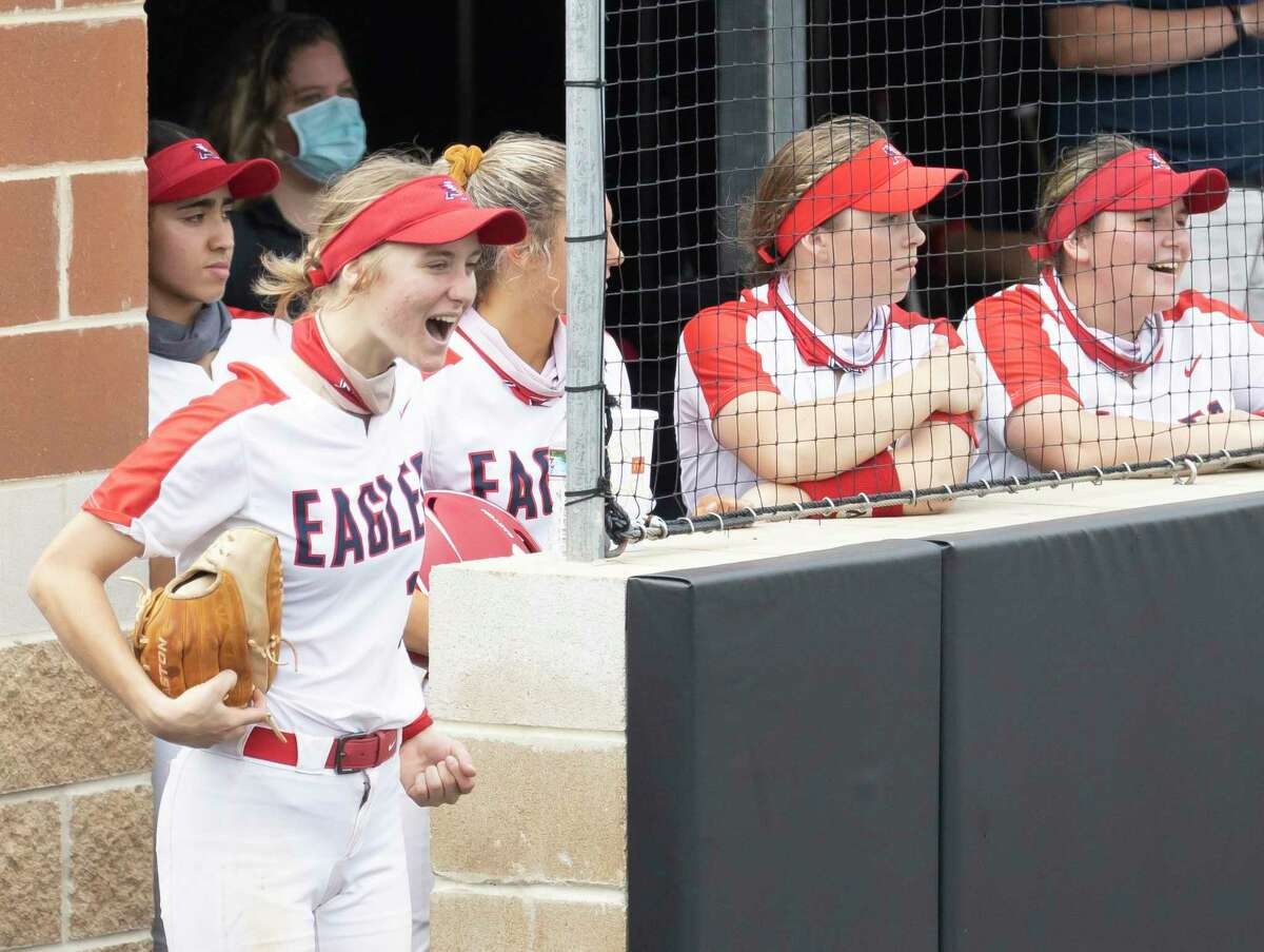 Atascocita softball players react after teammate Mikayla Garza hits a homerun during the sixth inning of a non-district softball game against Deer Park at Humble High School, Tuesday, March 16, 2021, in Humble.