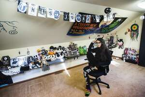 """Gi Padavana poses for a portrait with her collection of """"The Nightmare Before Christmas"""" memorabilia Thursday, Feb. 11, 2021 at her home in Midland. (Katy Kildee/kkildee@mdn.net)"""