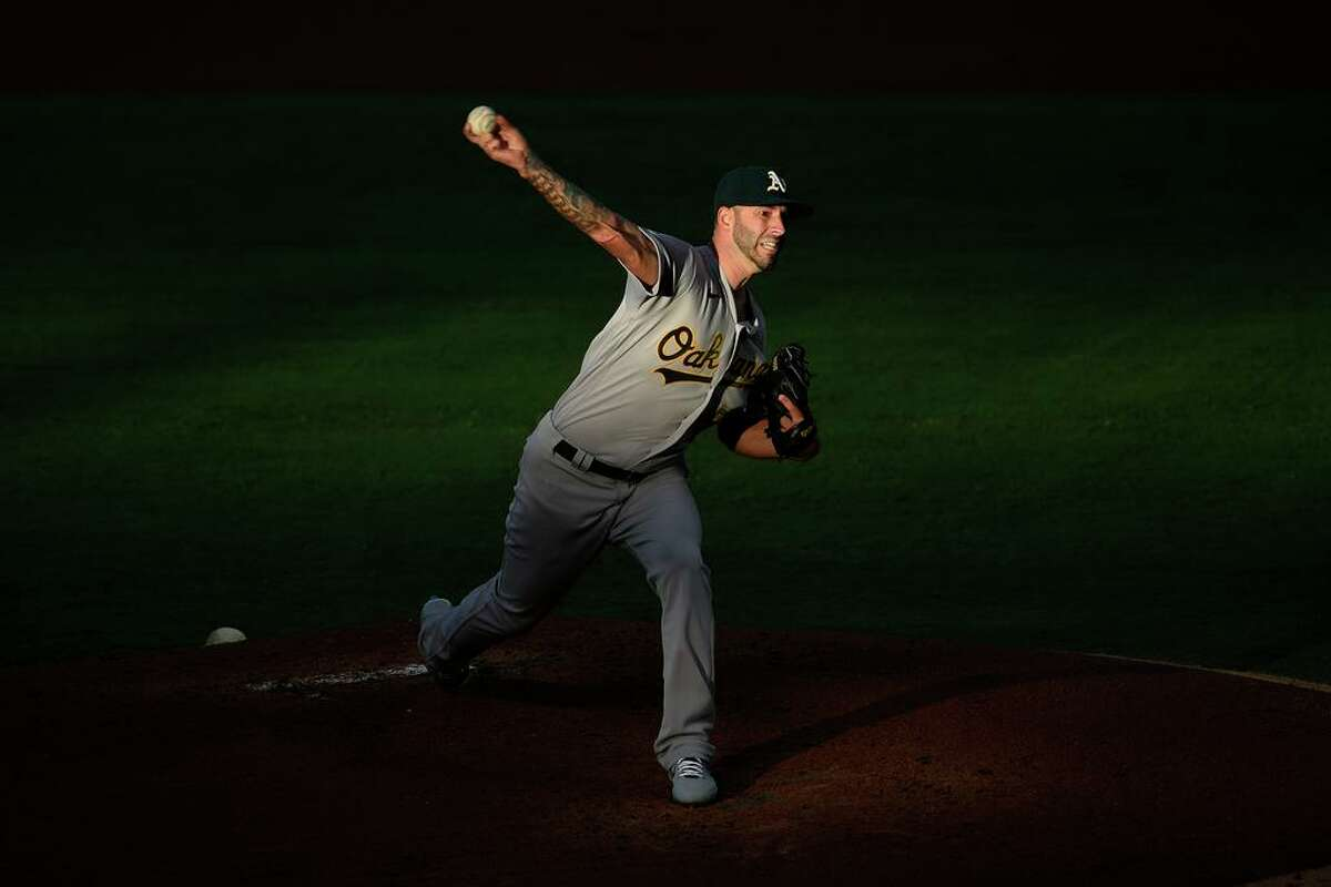 Oakland Athletics starting pitcher Mike Fiers delivers a pitch during the first inning of a baseball game against the Los Angeles Angels in Anaheim, Calif., Tuesday, Aug. 11, 2020. (AP Photo/Kelvin Kuo)