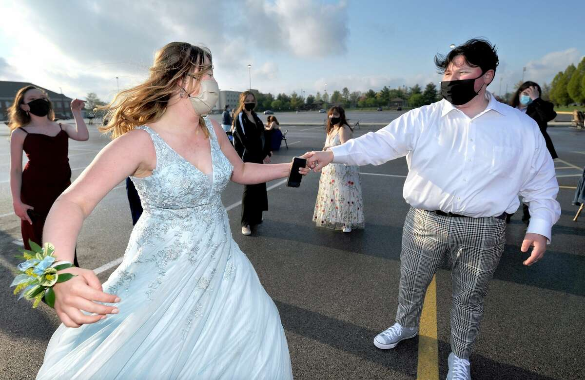 Riley Burns (left) and Tad Winslow dance in the parking lot of the Edwardsville High School prom.