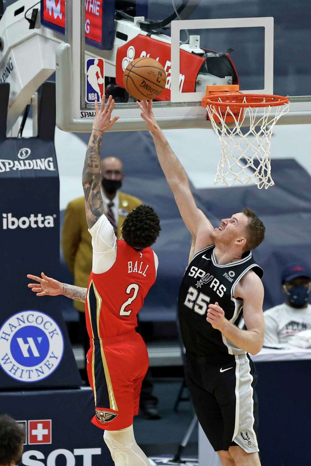 San Antonio Spurs center Jakob Poeltl (25) blocks a shot by New Orleans Pelicans guard Lonzo Ball (2) during the second half of an NBA basketball game in New Orleans, Saturday, April 24, 2021. (AP Photo/Rusty Costanza)