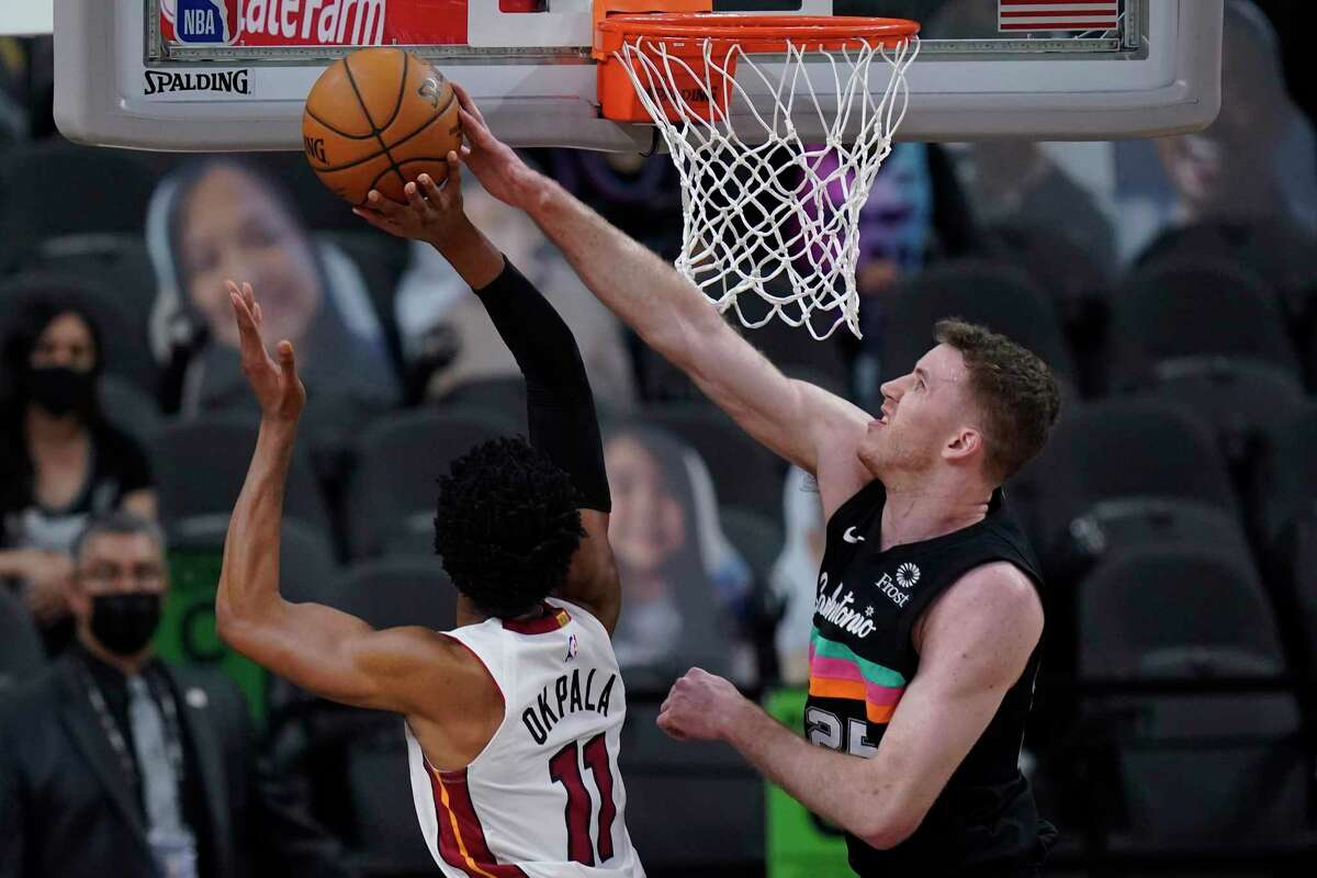 Miami Heat forward KZ Okpala (11) is blocked by San Antonio Spurs center Jakob Poeltl (25) during the first half of an NBA basketball game in San Antonio, Wednesday, April 21, 2021. (AP Photo/Eric Gay)