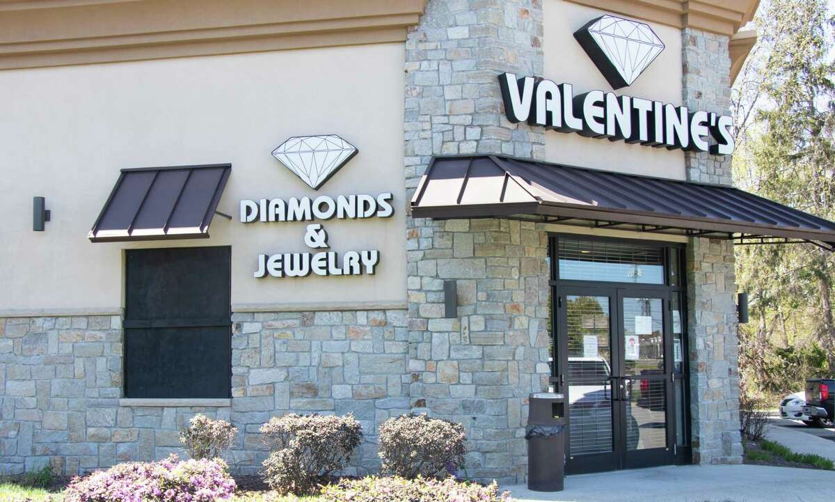Valentine's Diamond Center boards up the window the two suspects used to burglarize the establishment around 3:30 a.m. on Monday. The investigation of the burglary is still ongoing at this time.