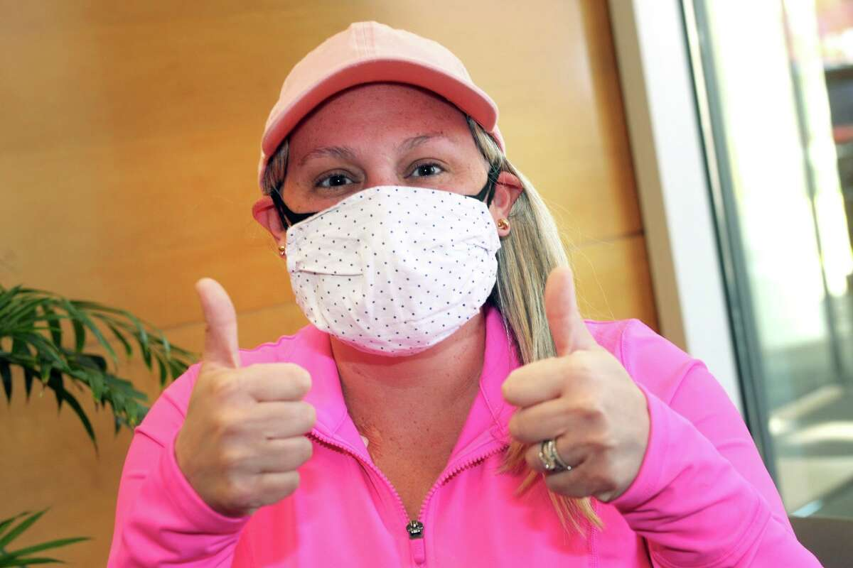 Maggie Mulcahy, a breast cancer patient from Trumbull, gives a couple of thumbs up after receiving her COVID-19 vaccination at St. Vincent's Medical Center, in Bridgeport, Conn. April 26, 2021.