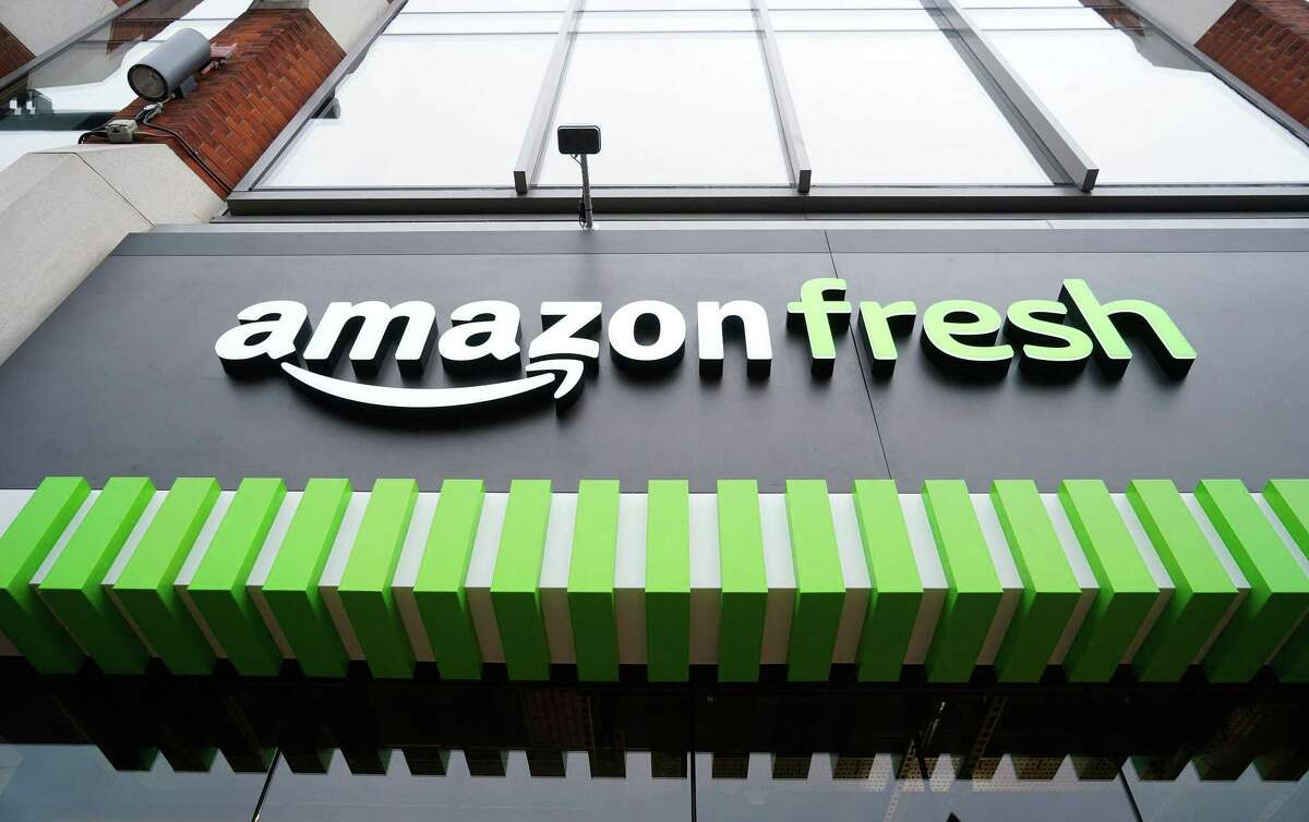 A logo is pictured above the entrance to a new Amazon Fresh store in Ealing, west London.
