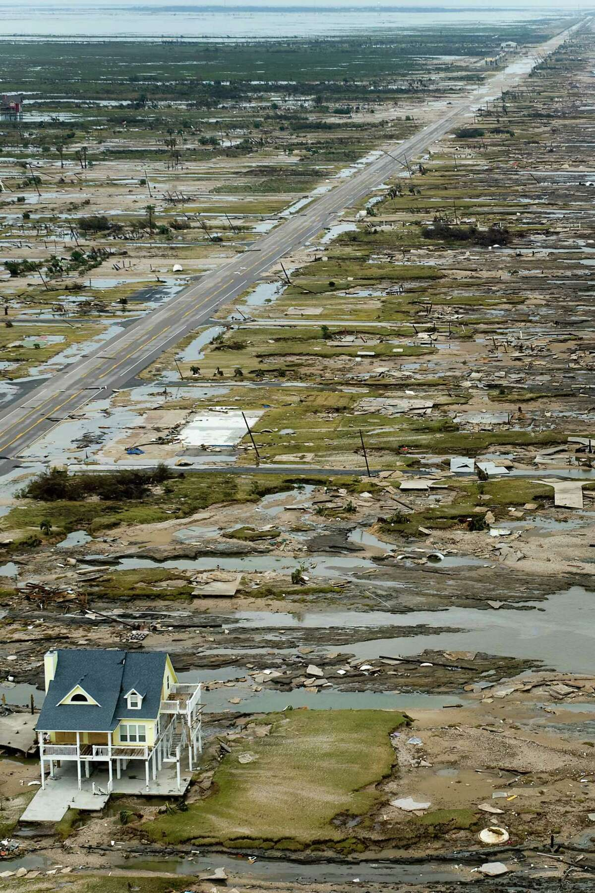 A single house is left standing amidst the devastation left by Hurricane Ike, Sunday, Sept. 14, 2008, in Gilchrist, Texas. ( Smiley N. Pool / Chronicle ) Warren and Pam Adams house is left standing amidst the devastation left by Hurricane Ike in Gilchrist.