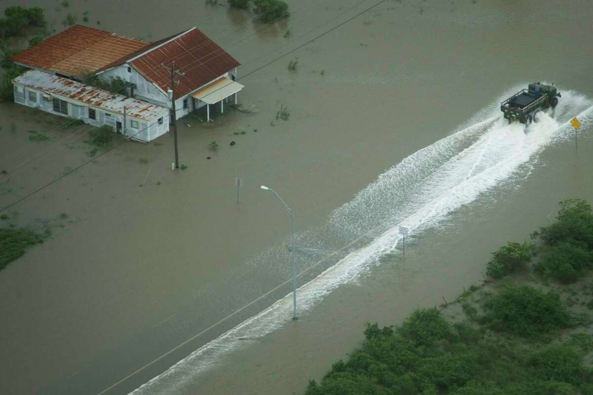 A truck drives through flood waters on the Bolivar Peninsula as Hurricane Ike approaches the Texas Gulf Coast on September 2008. June 1 is the official start of the Atlantic Hurricane Season and serves as a reminder to be prepared for severe weather.