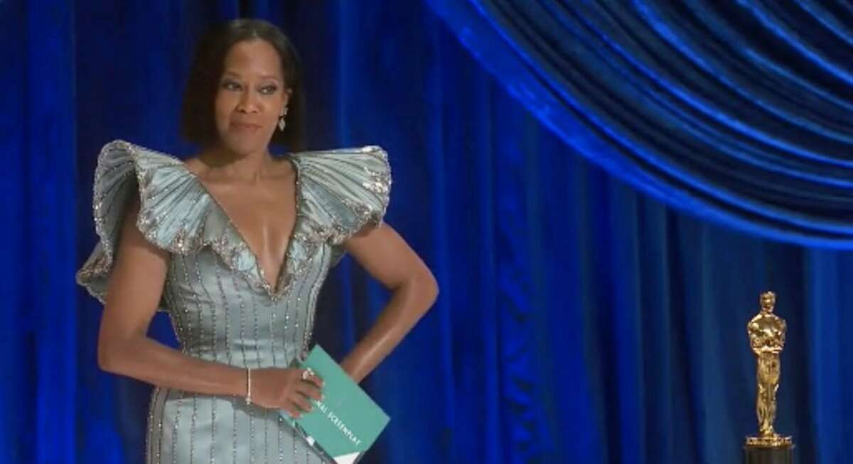 """Oscar-winning actress and """"One Night in Miami"""" director Regina King opened the 93rd Academy Awards on Sunday at Los Angeles' historic Union Station."""