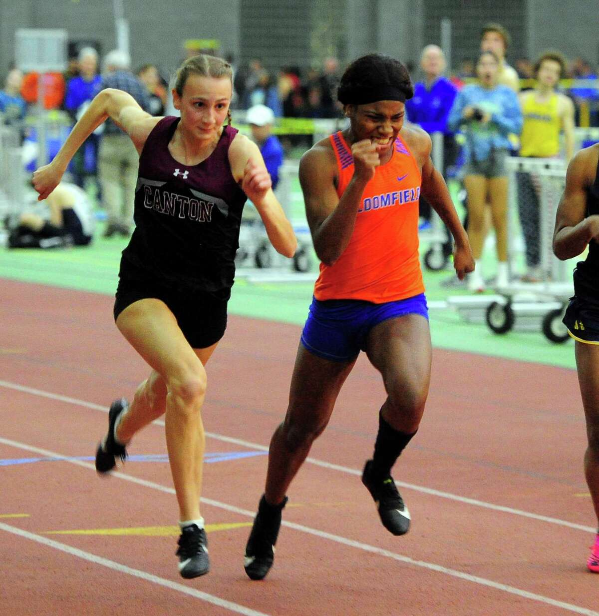 Canton's Chelsea Mitchell, and Bloomfield's Terry Miller compete in the 55 meter dash final during CIAC Class S Track & Field Championship action in New Haven, Conn., on Friday Feb. 14, 2020.