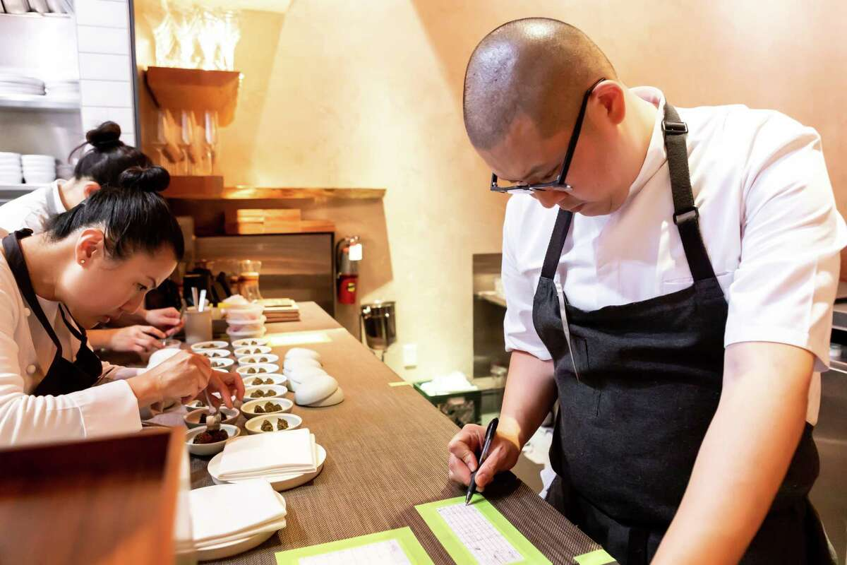 Chefs Meichih and Michael Kim prepares courses at Maum in Palo Alto, Calif. on Friday, April 26, 2019.