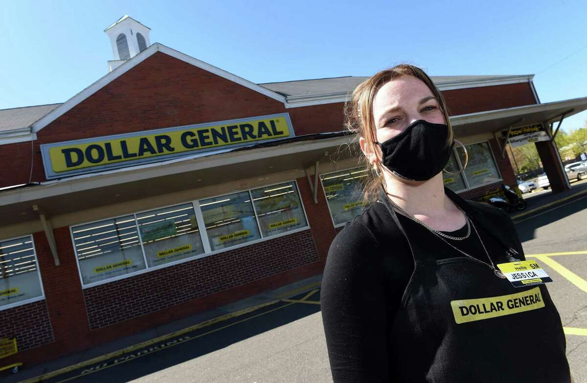 Store manager Jessica Dent photographed in front of the Dollar General on State Street in Hamden April 26, 2021.
