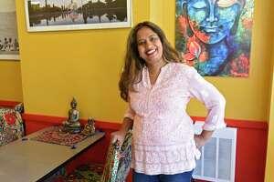 Owner Nafeesa Koslik stands in her restaurant Nani's Indian Kitchen on Monday, April 26, 2021 in Ballston Spa, N.Y. (Lori Van Buren/Times Union)