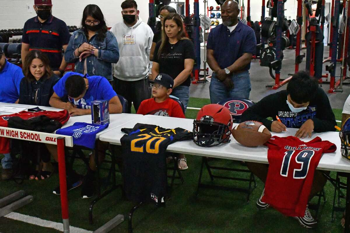 """Plainview seniors Aidan Heredia (left) and A.J. Igafo signed their letters of intent on Monday in the Coach Neil """"Bill"""" Billingsley Field House."""