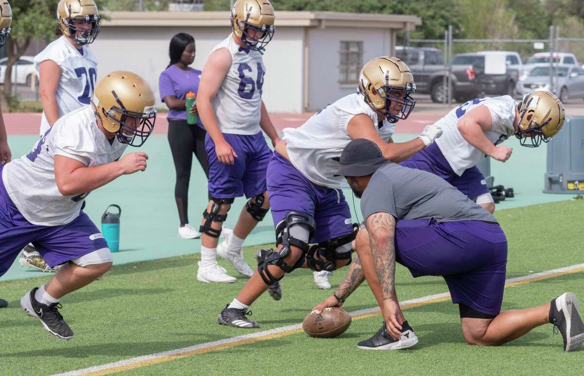 Midland High players run drills 04/26/2021 during the first day of spring football. Tim Fischer/Reporter-Telegram