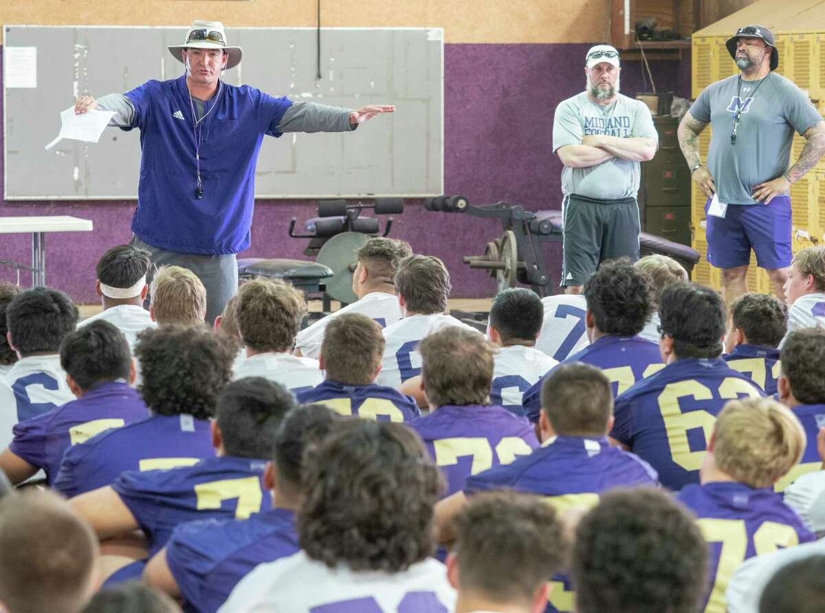 Midland High coach Thad Fortune talks with his players in the weight room 04/26/2021 as they get ready for the first day of spring football. Tim Fischer/Reporter-Telegram