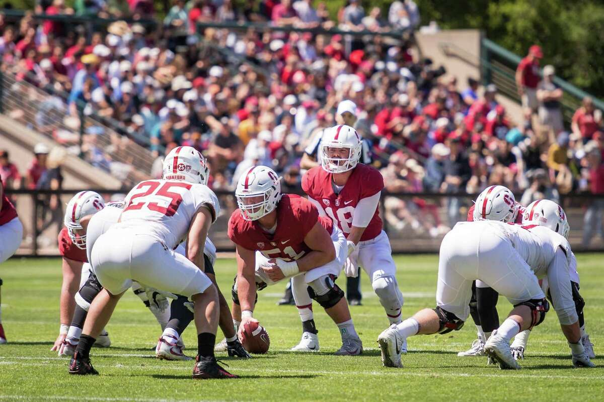 STANFORD, CA -- April 14, 2018: Center Drew Dalman, center, prepares to snap the ball to QB Jack Richardson during 2018 Stanford Spring Football game Saturday afternoon at the Laird Q. Cagan Stadium.