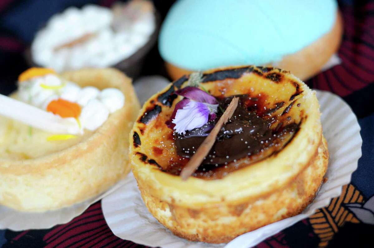 This chocolate-topped pay de queso (Mexican-style cheesecake) and other assorted pastries were made by Alebrije Bakery, which specializes in Mexican pastries made with decorative flair.