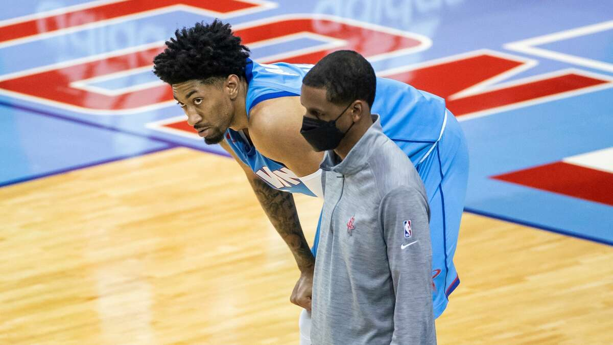 Houston Rockets center Christian Wood (35) looks down court along with Rockets head coach Stephen Silas after drawing a foul during the third quarter of an NBA game between the Houston Rockets and Denver Nuggets on Friday, April 16, 2021, at Toyota Center in Houston.