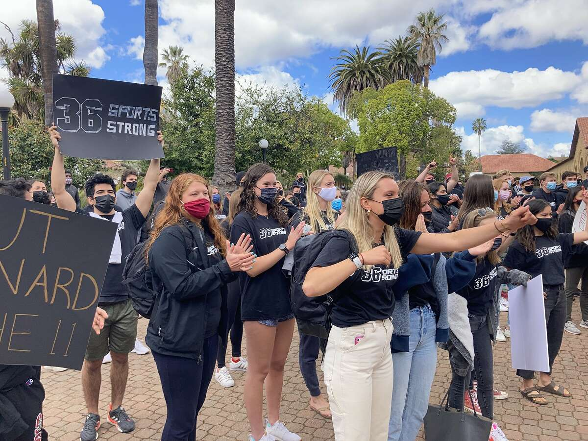 Stanford students protest the university's decision to cut nearly a dozen varsity sports outside the President and Provost's office at Stanford University on Monday, April 26, 2021 in Stanford, Calif.