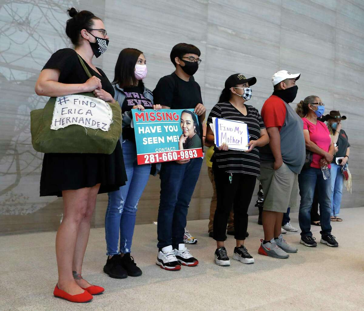 Friends and family of Erica Hernandez wait for Congresswoman Sheila Jackson Lee to start a press conference with law enforcement officials and the Hernandez family about the search for Hernandez, a Houston mother of three, who has been missing for a week at the Mickey Leland Federal Building, Monday, April 26, 2021, in Houston.