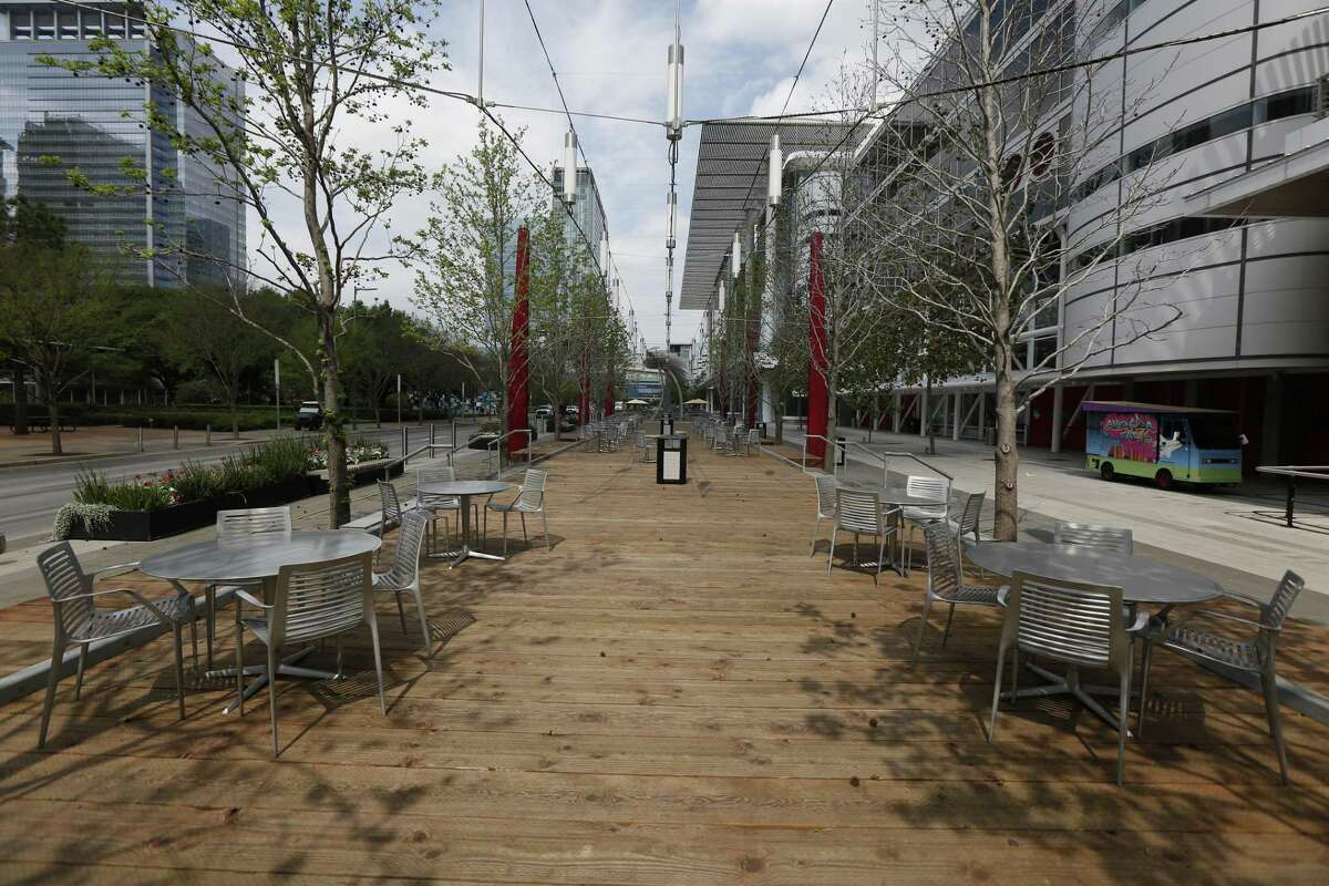 No one was at the George R. Brown Convention Center outdoor tables due to the coronavirus Tuesday, March 24, 2020, in Houston. More than a year later, a survey found that a majority of event planners, 71 percent, didn't anticipate events returning to 2019 levels until 2023.