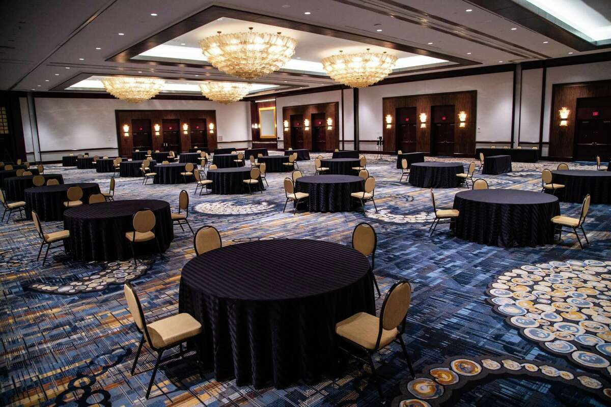 Hilton Americas-Houston Ballroom of the Americas prepared to keep guests seated apart for an event in November. Before the COVID-19 pandemic, the ballroom was prepared to hold up to 1,500 individuals. Now the room is prepared for 120 people. A recent survey found that a majority of event planners, 71 percent, didn't anticipate events returning to 2019 levels until 2023.