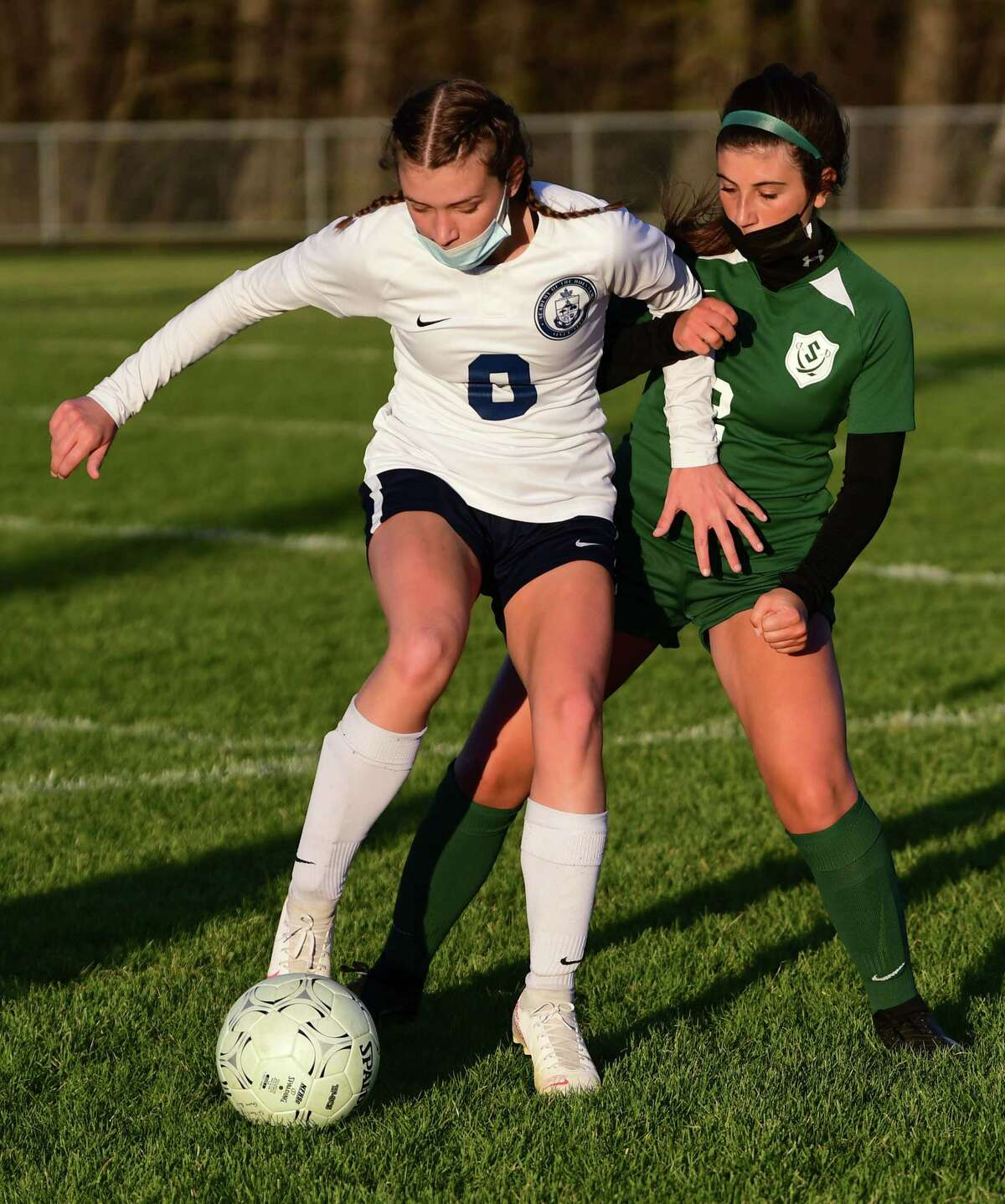 Academy of Holy Names' Elizabeth Harris, left, battles for the ball with Schalmont's Gabriela Amoroso during a soccer game on Monday, April 26, 2021 in Rotterdam, N.Y. (Lori Van Buren/Times Union)
