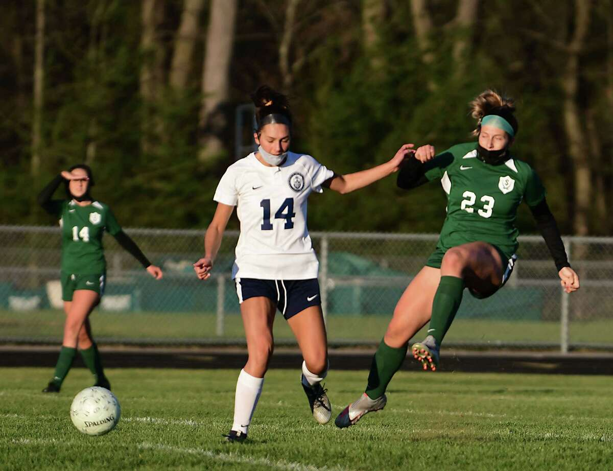 Academy of Holy Names' Nikita Granich, left, battles for the ball with Schalmont's Mia Defayette during a soccer game on Monday, April 26, 2021 in Rotterdam, N.Y. Granich scored the only goal in the game. (Lori Van Buren/Times Union)