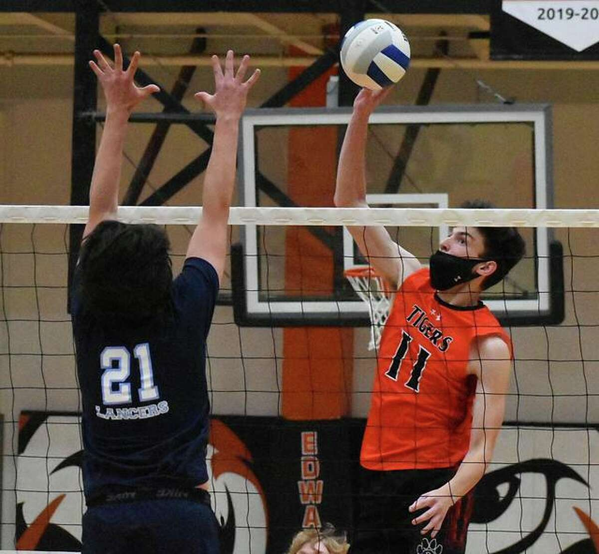 Edwardsville's Jacob Geisen slams down a kill during the first game against the Belleville East Lancers on Monday in Edwardsville.