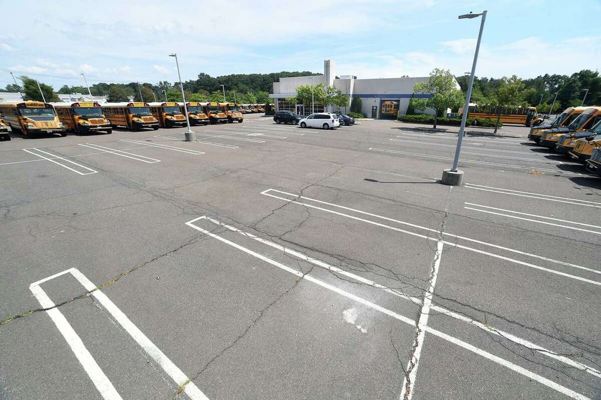 The parking lot outside of the former Sears Auto Center at the Connecticut Post Mall in Milford photographed on August 14, 2020 where a luxury apartment complex has been proposed.