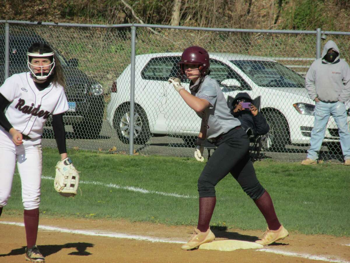 Naugatuck lead-off hitter Samantha Mullin, held on by Amelia Russell, was perfect in her first three at-bats in a close Greyhound win at Torrington High School Monday afternoon.