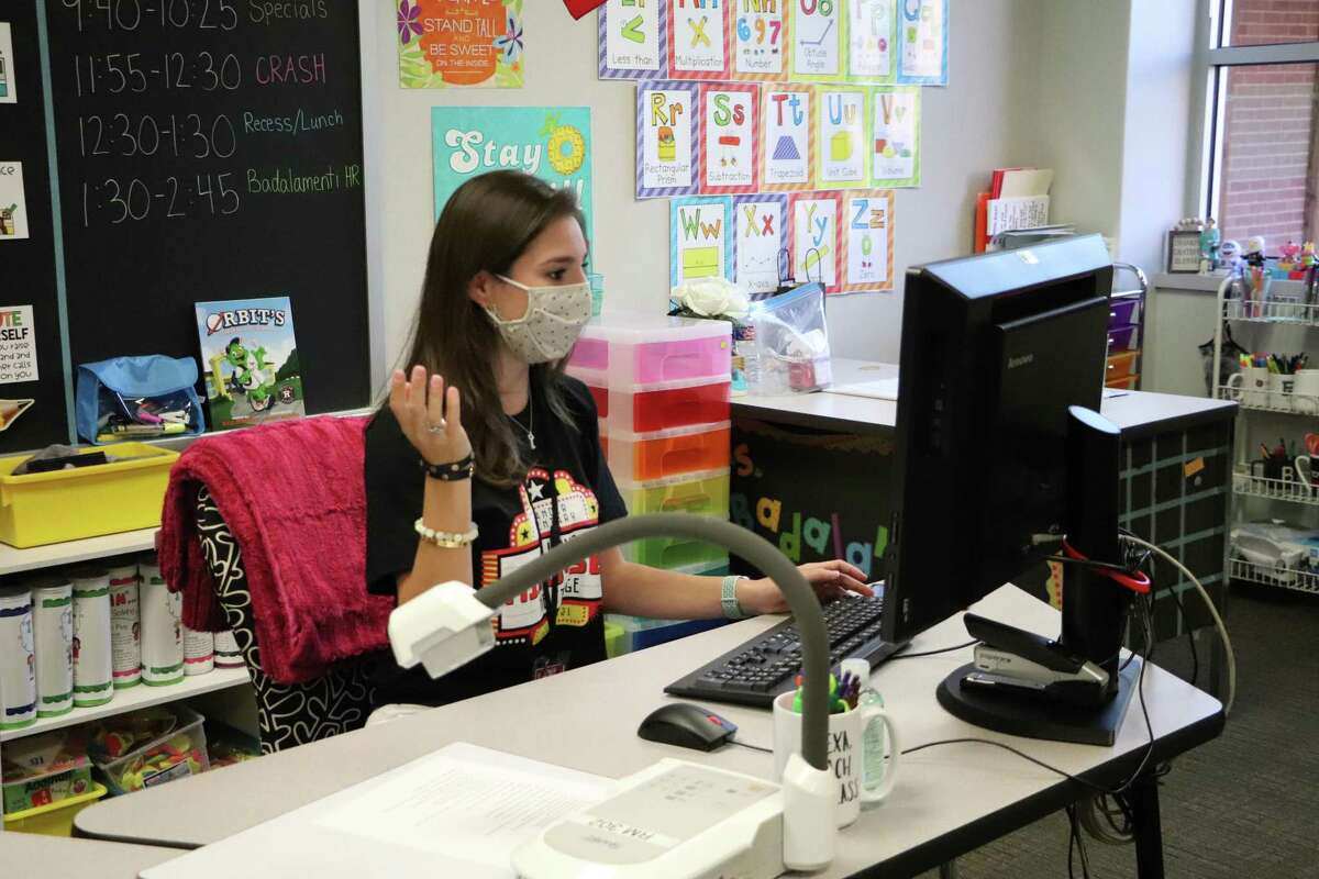 The Katy Independent School District board of trustees has approved a one-time lump sum payment for its employees following a trying year of the pandemic and winter freeze. Here, a teacher at Rylander Elementary works with students virtually on Sept. 19, 2020.