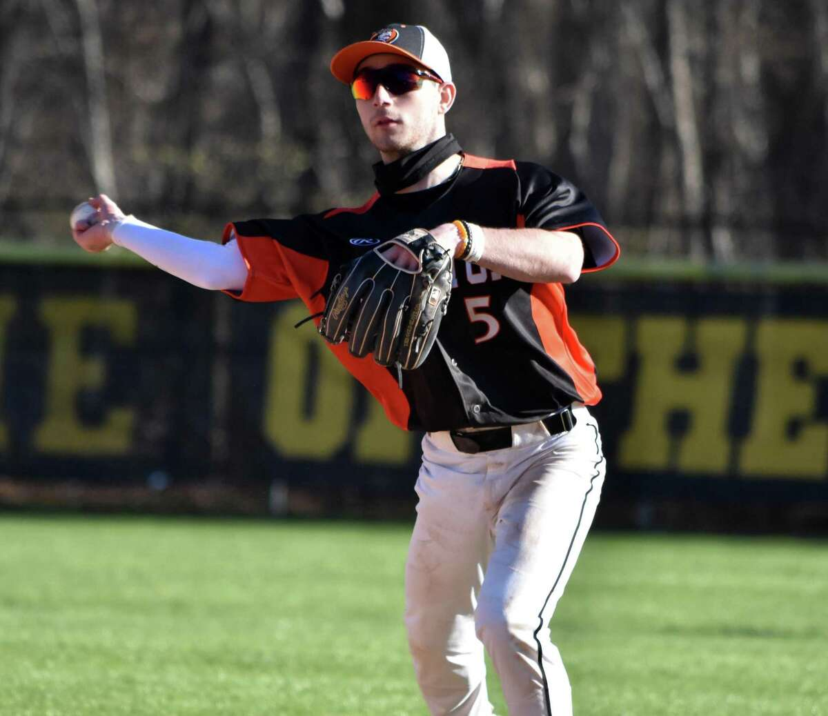 Shelton's John Riccio throws the ball to first against Hand in a baseball game at Hand high school on Monday, April 26, 2021.