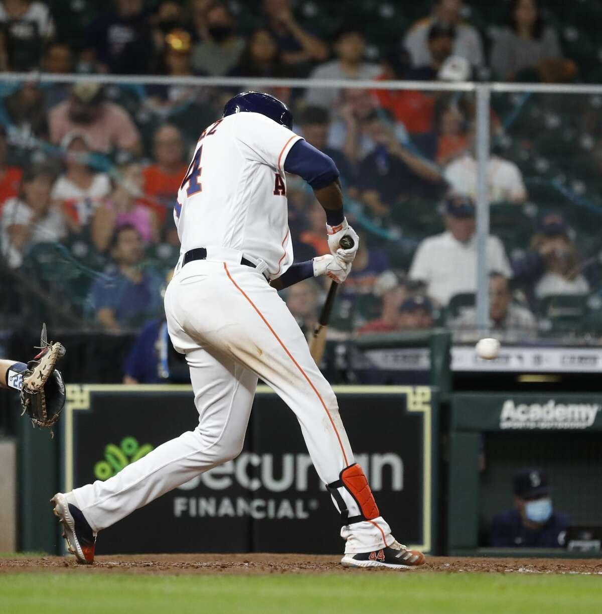 Houston Astros designated hitter Yordan Alvarez (44) singles during the seventh inning of an MLB baseball game at Minute Maid Park, Monday, April 26, 2021, in Houston.