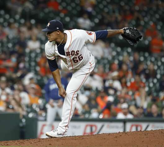 Houston Astros relief pitcher Bryan Abreu (66) pitches during the seventh inning of an MLB baseball game at Minute Maid Park, Monday, April 26, 2021, in Houston. Photo: Karen Warren/Staff Photographer / @2021 Houston Chronicle