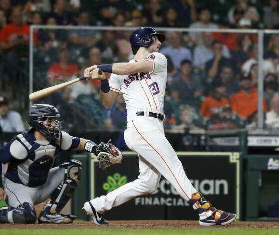 Houston Astros Kyle Tucker (30) hits a sacrifice fly to score Alex Bregman during the fifth inning of an MLB baseball game at Minute Maid Park, Monday, April 26, 2021, in Houston. Photo: Karen Warren/Staff Photographer / @2021 Houston Chronicle