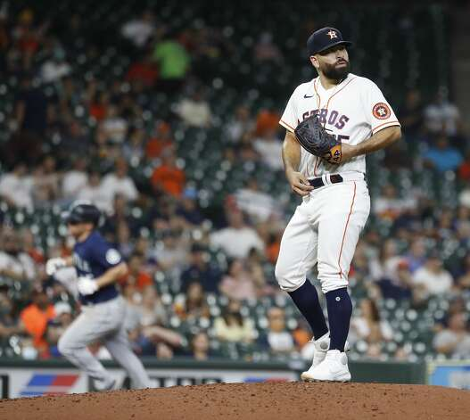 Houston Astros starting pitcher Jose Urquidy (65) reacts as Seattle Mariners Kyle Seager (15) runs the bases after his solo home run during the sixth inning of an MLB baseball game at Minute Maid Park, Monday, April 26, 2021, in Houston. Photo: Karen Warren/Staff Photographer / @2021 Houston Chronicle