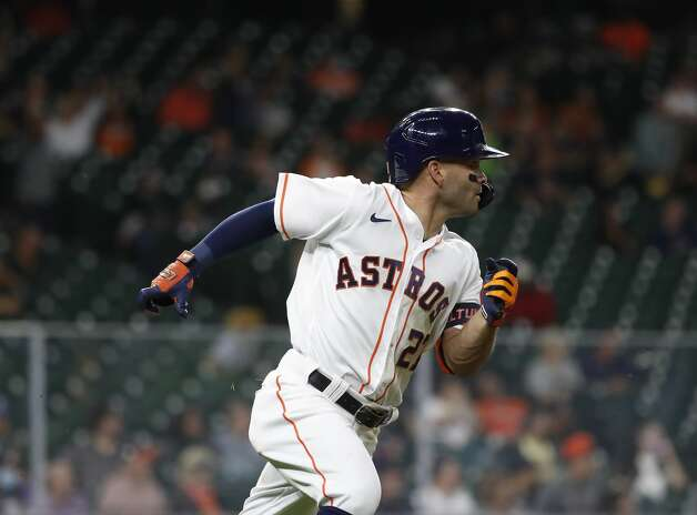 Houston Astros Jose Altuve (27) races to first base on is single during the sixth inning of an MLB baseball game at Minute Maid Park, Monday, April 26, 2021, in Houston. Photo: Karen Warren/Staff Photographer / @2021 Houston Chronicle