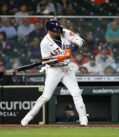 Houston Astros Yuli Gurriel (10) singles during the fifth inning of an MLB baseball game at Minute Maid Park, Monday, April 26, 2021, in Houston. Photo: Karen Warren/Staff Photographer / @2021 Houston Chronicle