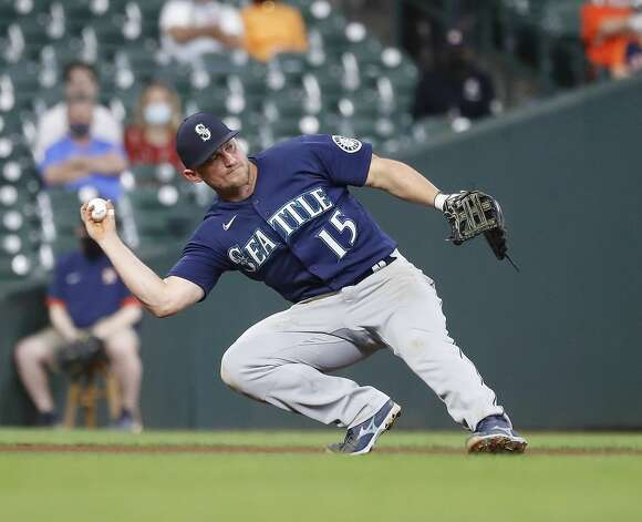 Seattle Mariners third baseman Kyle Seager (15) tries to get the ball to second base as Houston Astros Carlos Correa reached base on a fielder's choice during the fifth inning of an MLB baseball game at Minute Maid Park, Monday, April 26, 2021, in Houston. Photo: Karen Warren/Staff Photographer / @2021 Houston Chronicle