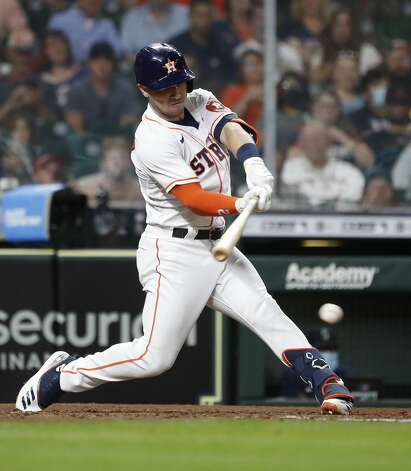 Houston Astros Alex Bregman (2) hits a single during the fifth inning of an MLB baseball game at Minute Maid Park, Monday, April 26, 2021, in Houston. Photo: Karen Warren/Staff Photographer / @2021 Houston Chronicle
