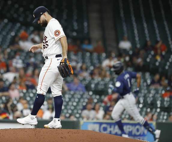 Houston Astros starting pitcher Jose Urquidy (65) reacts after Seattle Mariners Kyle Lewis' home run during the third inning of an MLB baseball game at Minute Maid Park, Monday, April 26, 2021, in Houston. Photo: Karen Warren/Staff Photographer / @2021 Houston Chronicle