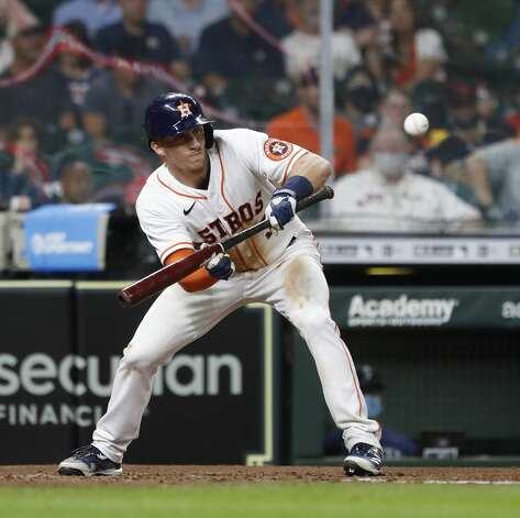 Houston Astros Myles Straw (3) bunts during the fourth inning of an MLB baseball game at Minute Maid Park, Monday, April 26, 2021, in Houston. Photo: Karen Warren/Staff Photographer / @2021 Houston Chronicle